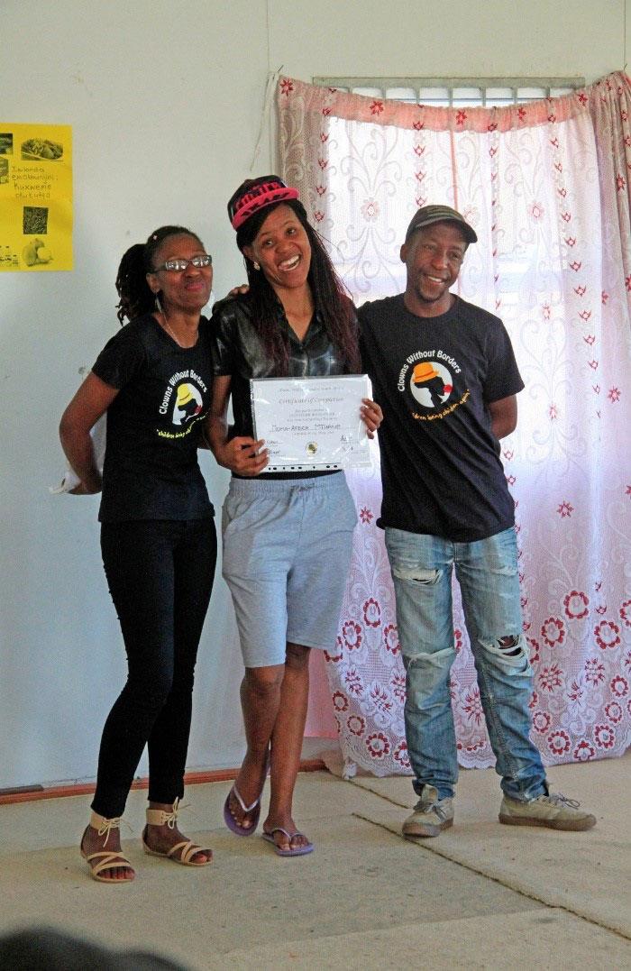 Feeling-proud-youth-particpant-receiving-storytelling-certificate-Khayelitsha-2016